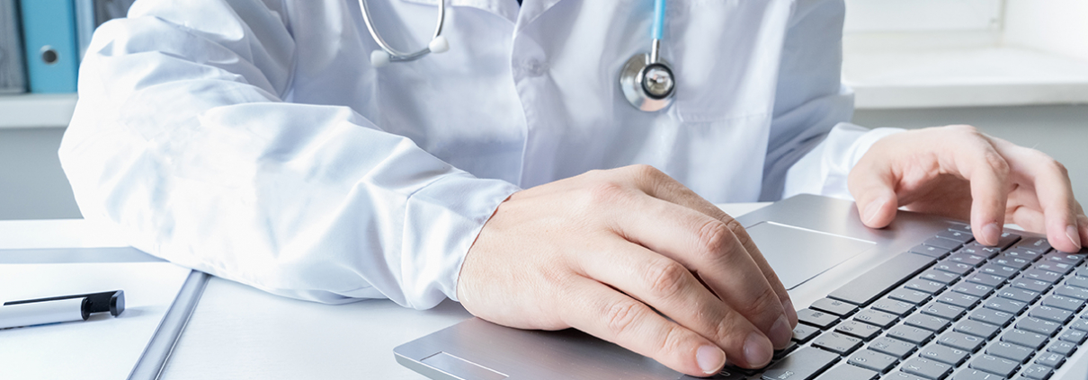 doctor using keyboard for virtual visit